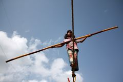 Street Trapeze Artist. A street trapeze artist performs the balancing act on a tight rope in India Royalty Free Stock Photo