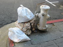Street Trash. Garbage on street corner Royalty Free Stock Photo