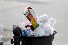 Street trash cans are filled with garbage cans with plastic bottles of scans up to the top. Royalty Free Stock Photos