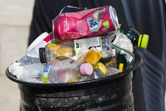 Street trash cans are filled with garbage cans with plastic bottles of scans up to the top. Royalty Free Stock Image