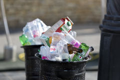 Street trash cans are filled with garbage cans with plastic bottles of scans up to the top. Stock Images