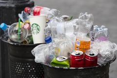 Street trash cans are filled with garbage cans with plastic bottles of scans up to the top. BUDAPEST, HUNGARY - 19 AUGUST 2017: Street trash cans are filled Stock Photos