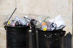 Street trash cans are filled with garbage cans with plastic bottles of scans up to the top. Stock Photography