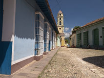 Street of Trinidad, Cuba. Colonial street with tower bell in historical center of Trinidad, Cuba Royalty Free Stock Image