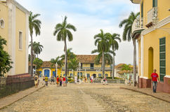 A street in Trinidad, Cuba. TRINIDAD/CUBA - 4 DECEMBER 2015 - people are walking in the Plaza Mayor on the 4th of december 2015 in Trinidad, Cuba Stock Photos