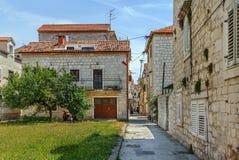 Street in Trogir, Croatia. Street with stone houses in Trogir old town, Croatia Stock Photo
