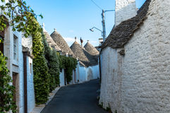 Street between trullo in Alberobello Royalty Free Stock Photo
