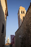Street with two old towers and a stone wall Royalty Free Stock Images