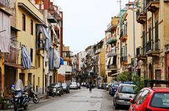 Street with typical Italian apartment buildings and shops in Palermo. Street with typical Italian apartment buildings the historical center of Palermo, Sicily royalty free stock photos