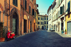 Street of a typical Italian town with bike and bicycle Royalty Free Stock Photos