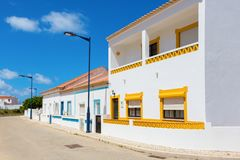Street with typical Portuguese white houses in Sagres, the municipality of Vila do Bispo, southern Algarve of Portugal royalty free stock photo