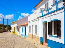 Street with typical Portuguese white houses in Sagres, southern Algarve of Portugal stock photo