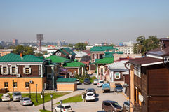 Street with typical Russian log cabins located in the Irkutsk Sloboda (130 Quarter) Royalty Free Stock Photography