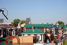 Street with typical Russian log cabins located in the Irkutsk Sloboda (130 Quarter) Royalty Free Stock Photos