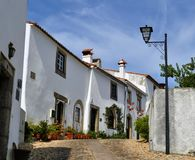 A street and the typical withe houses inside Marvão castle stock photos