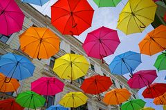 Street umbrellas over blue sky royalty free stock images