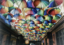 Street with umbrellas with rainbow color Stock Photos