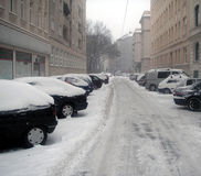 Street under snow. A street in Vienna, Austria, parked cars and a lot of snow Stock Images