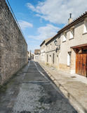 Street of Urueña with stone wall Stock Photo