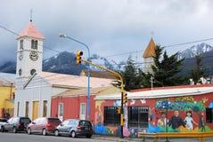 Street Ushuaia with 2 churches, Graffiti wall,  Argentina Stock Photo