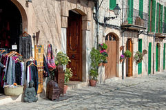 Street of Valldemossa, Majorca, Spain. Image shows part of Valldemossa, Majorca, Spain. A shop with some goods on the left, an old little street on the right and Stock Photos