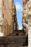 Street in Valletta. Typical street in Valletta with the traditional closed balconies and stairways Royalty Free Stock Photos