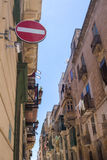 Street of Valletta, capital of island Malta. One of many narrow streets in the capital of island Malta - Valletta. View on the windows and balconies. No entry Royalty Free Stock Images