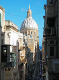 A street of Valletta, Malta with a view of the Carmelite Church Stock Images