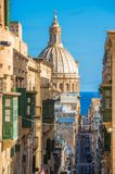 Street of Valletta with traditional balconies, Malta.  Royalty Free Stock Image