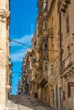 Street of Valletta with traditional balconies, Malta.  Royalty Free Stock Photos