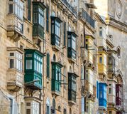 Street of Valletta with traditional balconies, Malta.  Stock Photos