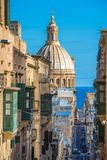 Street of Valletta with traditional balconies, Malta.  Royalty Free Stock Photo