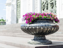 Street vase with beautiful flowers. Stands on the square Stock Photos
