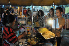 Street Vendor in Bangkok. A street vendor cooks noodles on Khao San Road on September 10, 2011 in Bangkok, Thailand. There are 16,000 registered street vendors Stock Images