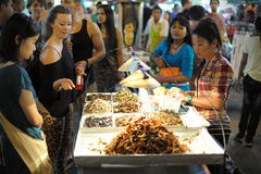 Street Vendor in Bangkok. A street vendor sells fried cockroaches and other insects to tourists on Khao San Road on August 23, 2012 in Bangkok, Thailand. There Stock Photos