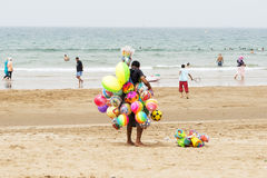 Street vendor on the beach Royalty Free Stock Photos