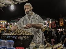 Street vendor of boiled snails in Marrakesh on the Djemaa El Fna square.