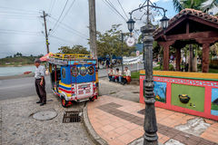 Street vendor on a brightly colored street in Guatape, Colombia. Guatape,Colombia- March 6, 2017: Street vendor on a brightly colored street in Guatape, Colombia Stock Photos