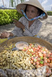 Street vendor in Can Tho. Vietnam, sales peanuts Royalty Free Stock Image