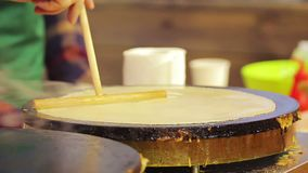 Street vendor cooking delicious pancakes for sale. Open-air food festival. Stock footage stock video