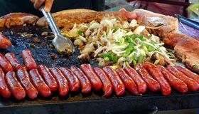 Street Vendor Cooks Meat Stock Photo