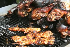 Street Vendor Food. Grilled chicken kabobs and turkey legs royalty free stock photos