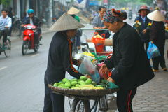 Street vendor of fruits on a pavement in Nam Dinh city Royalty Free Stock Image