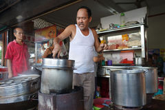 Street vendor with his noodle stall in Penang, Malaysia. Stock Images