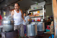 Street vendor with his noodle stall in Penang, Malaysia. Stock Photography