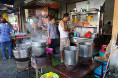 Street vendor with his noodle stall in Penang, Malaysia. Royalty Free Stock Images