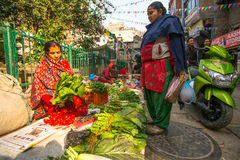 Street vendor in historic center of city. Largest city of Nepal, its economic center, a population of over 1 million people. KATHMANDU, NEPAL - NOV 28, 2013 Royalty Free Stock Images