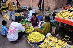 Street Vendor in India Selling Fruit Stock Photo