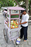 Street vendor of Indonesia. Street vendor selling mixed cut fruits on his mobile cart, Indonesia Stock Image