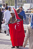 Street Vendor Near Istanbul Spice Market with Turkish Flags. ISTANBUL, TURKEY – APRIL 25: Unidenified street vendor selling Turkish flags prior to Anzac Day on Stock Images